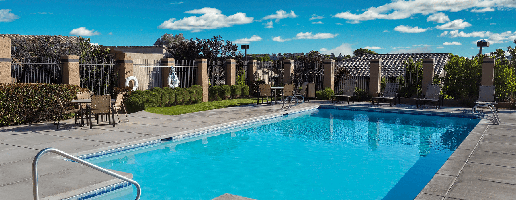 swimming pool with spacious seating areas and reclining chairs